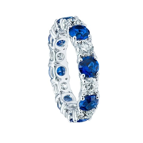 Round diamonds and blue sapphires eternity ring